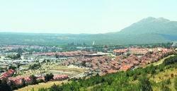 Vista de los nuevos desarrollos de San Lorenzo desde la ladera del monte Abantos / PLATAFORMA CIUDADANA ESCURIALENSE